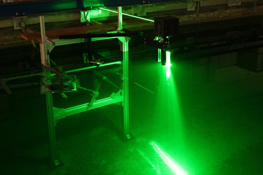 View of the PIV setup in the towing tank, which has been used for preliminary experiments. Coupling of the laser beam through the water surface.